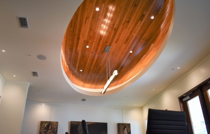 New Coastal Arts Center with old hotel flooring accenting room ceiling