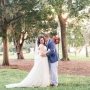 A photo of a bride and groom on the grounds of the Coastal Arts Center of Orange Beach