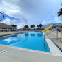 Deep end of the pool, diving board and slide at Orange Beach Aquatics Center