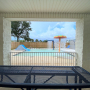 Covered seating area overlooking Children's Wading Pool with Spray Features and Slide at Orange Beach Aquatics Center