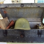 Trunk with helmet and other gear from WWII at the Orange Beach Indian Sea Museum.