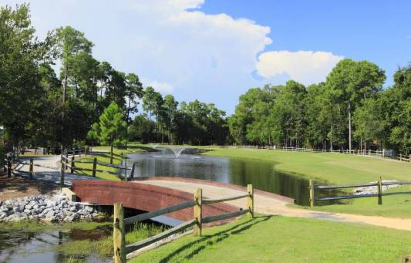 Pond with fountain and golf cart bridge at Orange Beach Golf Center