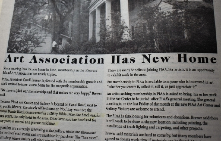 Newspaper clipping showing Pleasure Island Art Association moving to old hotel building in 2000s