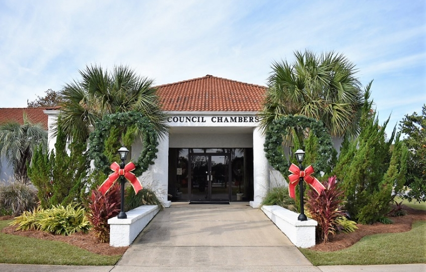 A photo of the entrance to the Orange Beach Council Chambers decorated with Christmas decorations.