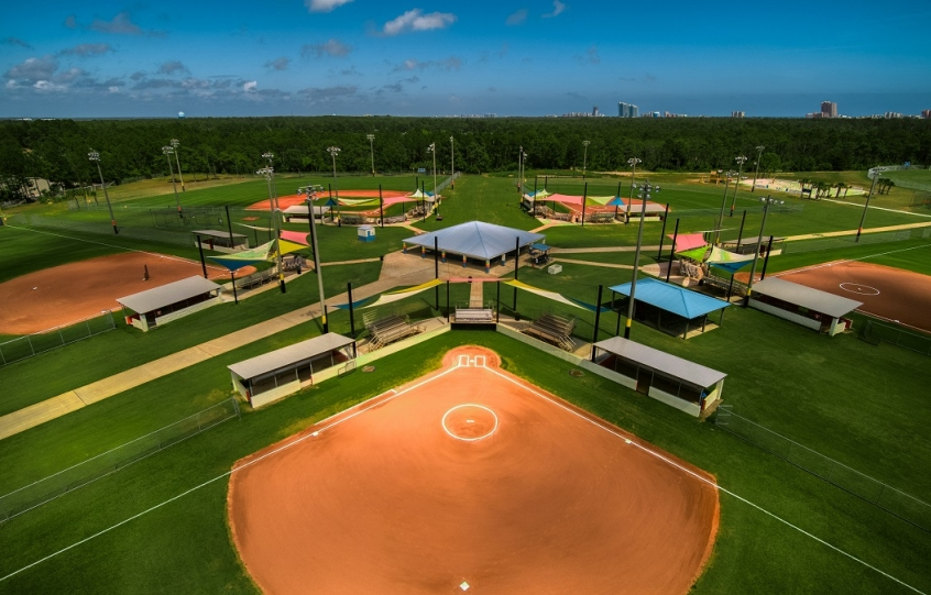 City of Orange Beach Sportsplex aerial wideshot of Fields 1-5 for baseball and softball showing off upgrades of shades for spectators and new dugouts and backstop netting