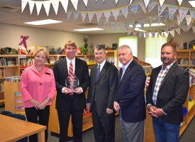 Orange Beach Elementary Principal Ryan Moss, second from left, holds the Attorney General's Alabama Safe Schools Initiative 2018 Award of Excellence with from left Baldwin County School Board member Norma Hoots Lynch, Alabama Attorney General Steve Marshall, Baldwin County Schools Superintendent Eddie Tyler, and Orange Beach Mayor Tony Kennon.