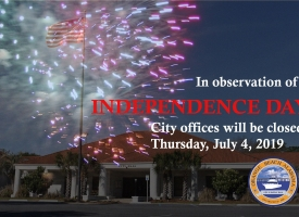 Graphic showing city hall with fireworks and words saying city offices will be closed for the holiday on Thursday, July 4, 2019