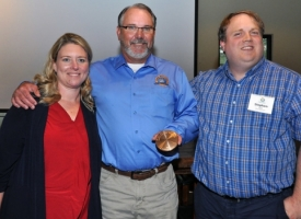 Gulf of Mexico Climate and Resilience Community of Practice Members Tracie Sempier, left, and Stephen Deal, right, congratulate Lannie Smith.