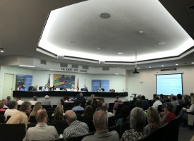 Orange Beach Planning Commission shown during meeting on August 12, 2019 with a large crowd in the Council Chambers